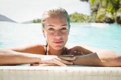Portrait of beautiful blonde in the pool Stock Images