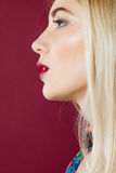 Portrait of Beautiful Blonde with Professional Makeup in Studio. Woman Face with Clean Perfect Skin on Pink Background. royalty free stock photography