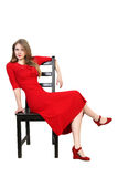 Portrait of  beautiful blonde in red dress Royalty Free Stock Photography