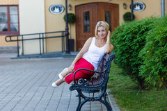 Portrait of a beautiful blonde in red pants Royalty Free Stock Images