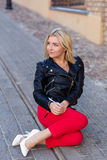 Portrait of a beautiful blonde in red pants Royalty Free Stock Photos