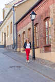 Portrait of a beautiful blonde in red pants Stock Photo