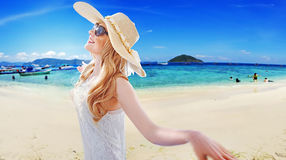 Portrait of a beautiful blonde resting on the beach. Portrait of a beautiful blonde resting on the tropical beach Stock Image