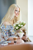 Portrait of a beautiful blonde smiling with flowers Stock Photos