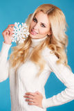 Portrait of a beautiful blonde with snowflake hands. Stock Photography