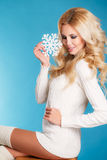 Portrait of a beautiful blonde with snowflake hands. Stock Images