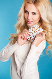 Portrait of a beautiful blonde with snowflake hands. Royalty Free Stock Photography