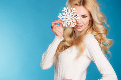 Portrait of a beautiful blonde with snowflake hands. Royalty Free Stock Photos