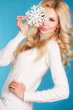 Portrait of a beautiful blonde with snowflake hands. Stock Image