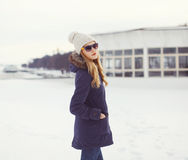 Portrait of beautiful blonde in urban winter style Royalty Free Stock Photo