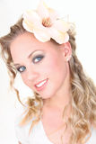 Portrait of beautiful blonde woman. Portrait of beautiful young woman with flower Royalty Free Stock Photos