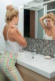 Portrait of beautiful blonde woman in bathroom stock image