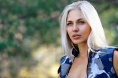 Portrait of beautiful blonde woman in camouflage royalty free stock photography