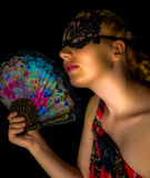 Portrait of beautiful blonde woman with fan Royalty Free Stock Image