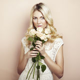 Portrait of a beautiful blonde woman with flowers Royalty Free Stock Photography