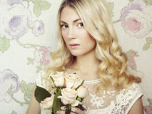 Portrait of a beautiful blonde woman with flowers Royalty Free Stock Photo