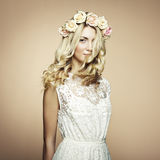 Portrait of a beautiful blonde woman with flowers in her hair Stock Image