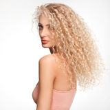 Portrait of Beautiful Blonde Woman . Healthy Long Curly Hair. Stock Photo