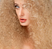 Portrait of Beautiful Blonde Woman . Healthy Long Curly Hair. Stock Photos