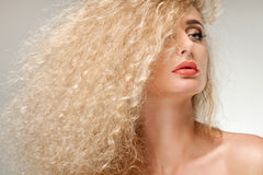 Portrait of Beautiful Blonde Woman .Healthy Long Curly Hair. Royalty Free Stock Photos