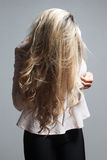 Portrait of a beautiful blonde woman hiding behind her hair Royalty Free Stock Photo