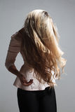 Portrait of a beautiful blonde woman hiding behind her hair Stock Photos