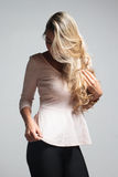 Portrait of a beautiful blonde woman hiding behind her hair Royalty Free Stock Photos