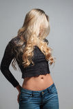 Portrait of a beautiful blonde woman hiding behind her hair Royalty Free Stock Images