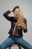 Portrait of a beautiful blonde woman hiding behind her hair Stock Photography