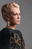 Portrait of beautiful blonde woman looking away. Royalty Free Stock Images