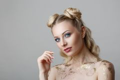 Portrait of beautiful blonde woman with makeup beauty photoshoot on background stock photo