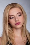 Portrait of a Beautiful Blonde Woman Model black background studio - Stock Image Royalty Free Stock Image