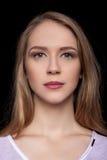 Portrait of a Beautiful Blonde Woman Model black background studio - Stock Image Stock Photo