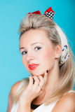 Portrait beautiful blonde woman pinup girl retro style on blue Royalty Free Stock Image