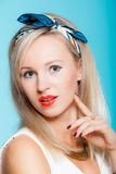 Portrait beautiful blonde woman pinup girl retro style on blue Royalty Free Stock Photo