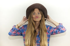 Portrait of beautiful blonde woman with plaid shirt and a cowboy Royalty Free Stock Photos