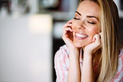 Portrait of a beautiful blonde woman smiling. Stock Image