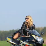 Portrait of a beautiful blonde woman. On a sports motorcycle Royalty Free Stock Photography