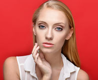 Portrait of the beautiful blonde woman in studio Royalty Free Stock Images