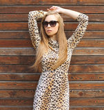 Portrait of beautiful blonde woman wearing a leopard dress Royalty Free Stock Image