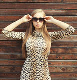 Portrait beautiful blonde woman wearing a leopard dress and sunglasses Stock Photography