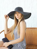 Portrait of beautiful blonde woman wearing a straw hat Stock Photography