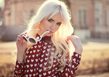 Portrait of beautiful blonde young woman outdoors Stock Images