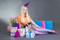 Portrait of beautiful blondie girl with gifts and flowers Royalty Free Stock Photos