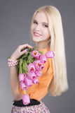 Portrait of beautiful blondie girl with tulips Stock Photo