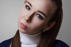 Portrait of a beautiful blue-eyed young woman Royalty Free Stock Images