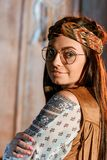 Portrait of beautiful bohemian girl in headband. And glasses royalty free stock photography