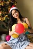 beautiful girl portrait at Christmas tree stock photo