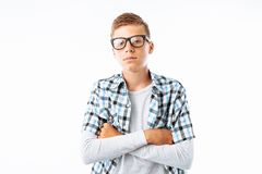 Portrait of beautiful boy with glasses, teen nerd smiling, in Studio on white background royalty free stock images