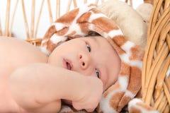 Portrait of Beautiful Boy Lying in Wicker Basket Royalty Free Stock Photos